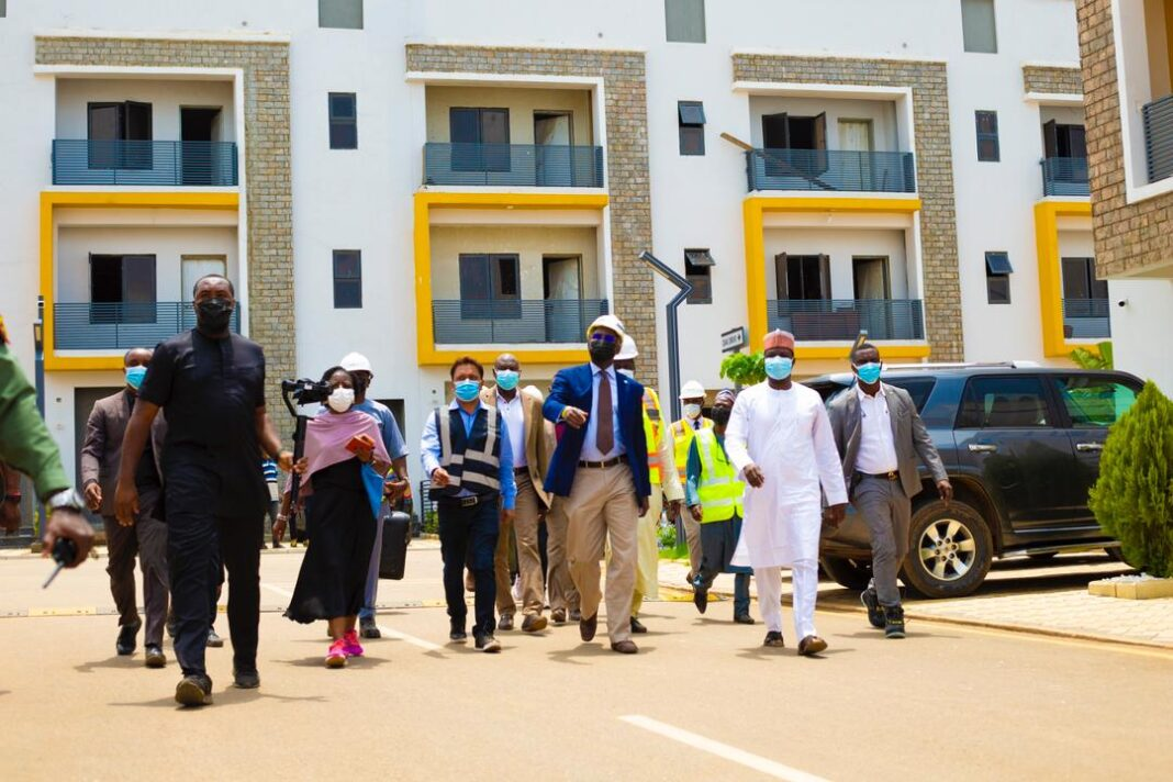 The Chairman, Cosgrove Investment Limited, Mr Umar Abdullahi (2nd From Right) conducting the Honorable Minister of Works and Housing, Mr Babatunde Fashola SAN around the premises of Cosgrove Smart Estate, Wuye, Abuja, during the visit of the minister to the company, on Tuesday.