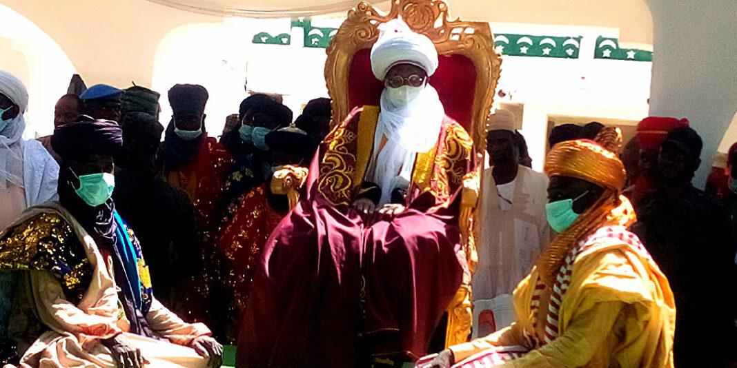 Minister of Information and Culture, Alhaji Lai Muhammed (M), being decorate as Turbanning 'Kakakin Kabi' By Emir of Argungu, Alhaji Samaila Mera in Kebbi State on Sunday (26/9/21). 04379/26/9/2021/ Ibrahim Bello/ OTU/NAN