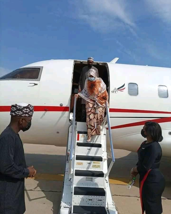 Mrs Ganduje alighting from an aircraft on Tuesday morning