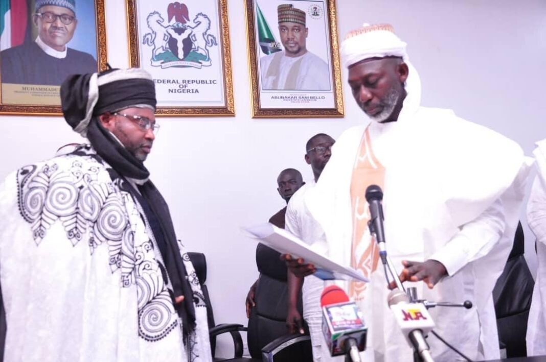 Governor Abubakar Sani Bello, represented by the Commissioner for Local Government, Community Development and Chieftaincy Affairs, Emmanuel Umar, presents appointment letter to the new Emir of Kontagora (Sarkin Sudan) on Friday, October 8, 2021