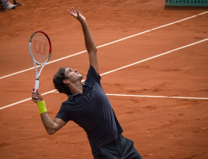 Roger Federer playing tennis at Roland Garros