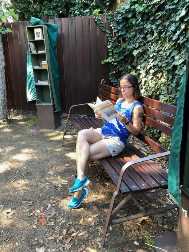 Me reading in Grazia Deledda's internal home courtyard