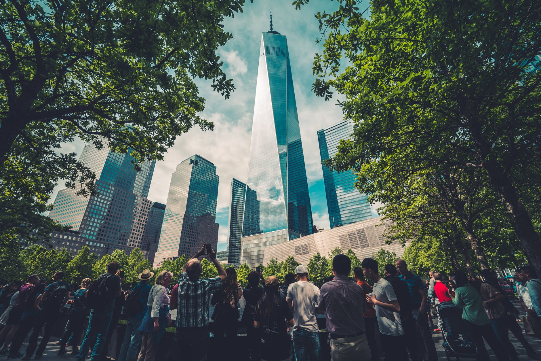 people standing across glass building