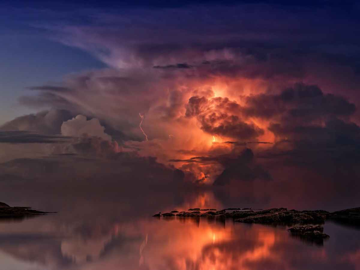 reflection of clouds on body of water