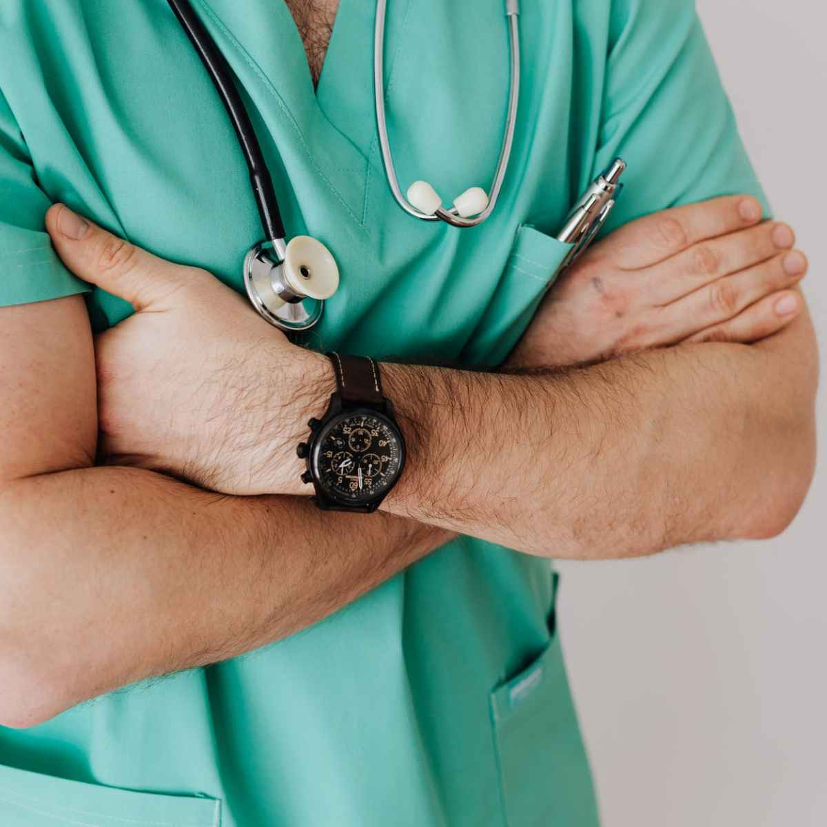 unrecognizable crop man in wristwatch with stethoscope