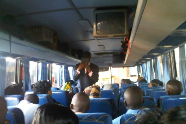Bus Preacher beaten to pulp after condoms fell out of his bible