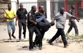 Image result for police arresting nigerian men