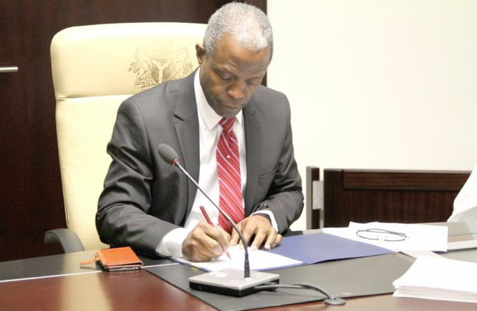 Image result for Osinbajo signs three bills into law