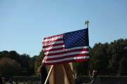 """Fans and players pause, placing hands over hearts, and saluting the flag during the """"Star Spangled Banner"""" at Regent's Virginia Beach VA campus, Saturday, Nov. 12, 2016. (Nicolas Reynolds)"""