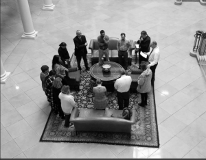Regent Law staff members gather in Robertson Hall to pray for the students taking the Bar Exam. Feb. 2018. (Photo courtesy of Regent Law Twitter)