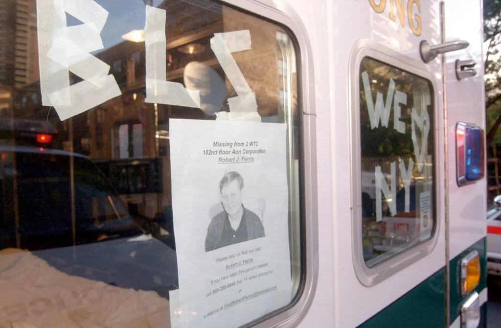 A missing person flyer is posted on the rear window of an ambulance as families all over New York City and the nation try to locate missing loved ones. (Photo: UPI Photo Service/Newscom)