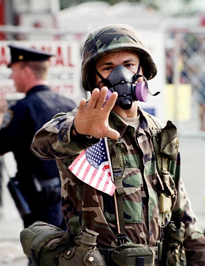 A National Guardsman directs pedestrian traffic near the World Trade Center terrorist attack site in New York, September 19, 2001. (Photo: UPI Photo Service/Roger L. Wollenberg/Newscom)