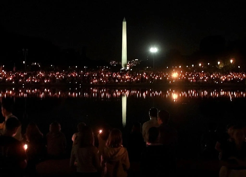 Thousands of people take part in a candlelight vigil on the National Mall in Washington D.C. September 12, 2001. (Photo: REUTERS/Win McNamee/Newscom)