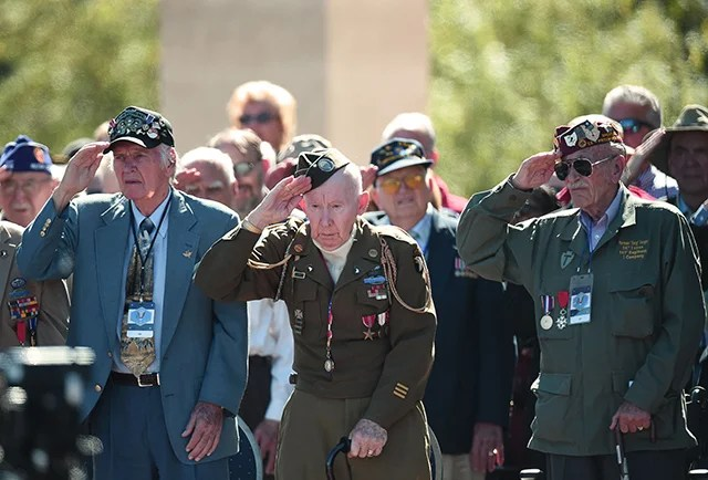American veterans salute during a joint French-US D-Day commemoration ceremony at the Normandy American Cemetery and Memorial in Colleville-sur-mer, Normandy, on June 6, 2014, marking the 70th anniversary of the World War II Allied landings in Normandy. (Photo: AFP PHOTO/DAMIEN MEYER)