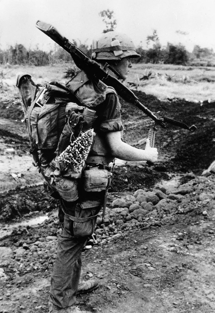 Marine Frank Bunton s prepared for Christmas as he carries a tree while on a search and destroy mission near the Demilitariezed Zone north of Con Thien, Vietnam. (Photo:  Keystone Pictures/Newscom)