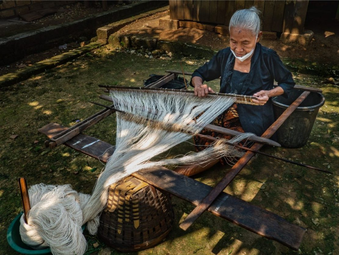 Old lady threading the Suri at Sekar Kawung Indonesia. Supplied.