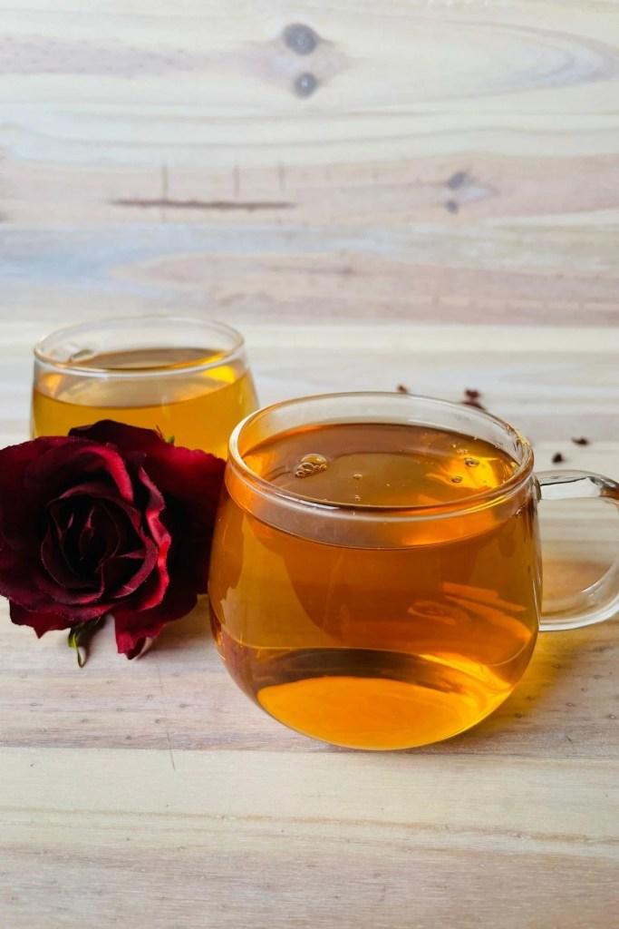 rose hip tea in tea cups with rose