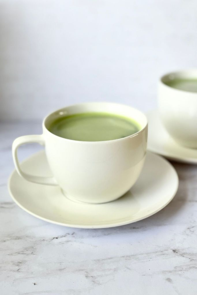 cup of matcha latte with saucer