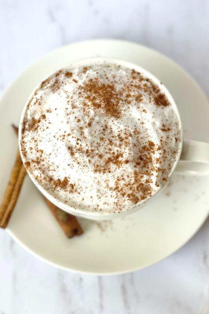 pumpkin chai latte with cream and cinnamon