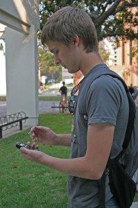 Panic· Junior Clark Kromenaker, accesses the new panic button application on his smartphone. - Dieuwertje Kast | Daily Trojan