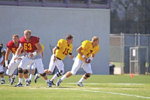 Back in action · Aaron Corp (15), practicing for the first time since cracking his fibula, must beat out Matt Barkley for the starting spot. - Mike Lee | Daily Trojan