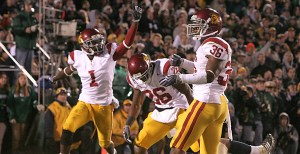 The USC Trojan defense celebrates after what they thought was the last play of the game. Notre Dame got one more chance, but the defense came through with the stop. - Dieuwertje Kast | Daily Trojan