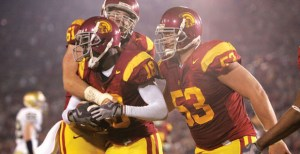 Damian Williams (18) celebrates with Jeff Byers (53) and Kristofer O'Dowd (61) after a touchdown against Notre Dame in 2008.