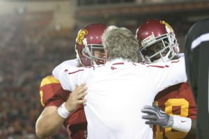 Pete hugs Barkley and Damian after the final touchdown in the fourth quarter that Damian Williams scored. - Dieuwertje Kast   Daily Trojan