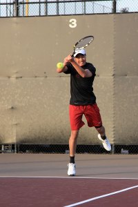 Given a chance · Senior Michael Tang, who previously served as team manager, played against UC Irvine in his first-ever match. - Ralf Cheung | Daily Trojan