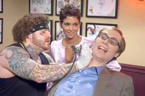 Painful comedy · Halle Berry looks on as co-star Stephen Merchant gets a new tattoo. Scenes as eccentric as this one are all too common throughout Movie 43, which thrives on crass, tasteless humor. - Courtesy of Relativity Media