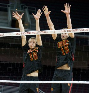 Aiming high · Freshman middle blocker Josh Kirchner (18) and redshirt sophomore outside hitter Joey Booth go for the block at the net. - Ralf Cheung | Daily Trojan