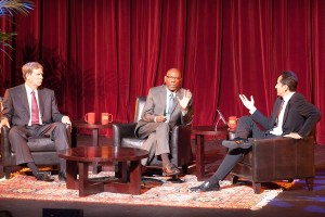 In debt · Harlem Children's Zone President Geoffrey Canada speaks to the event moderator, professor David Belasco, about the federal debt. - Ralf Cheung | Daily Trojan