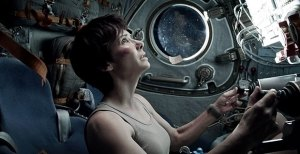 No air · Sandra Bullock plays Dr. Ryan Stone in Gravity, an intense thriller about a Hubble Space Telescope repair expedition that goes awry. Bullock's performance draws the audience in and elevates the tension of the film. - Courtesy of Warner Bros. Press
