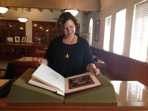 Bookworm · USC Libraries Special Collections archivist Michaela Ullmann glances over historical poems at Doheny Memorial Library. - Deena Khattab | Daily Trojan