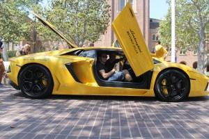 Vroom vroom · Aaron Bajor (front), president of the USC Auto Club, and Ryan McLean (back), secretary of the USC Auto Club, strike a pose in a Lamborghini, one of the cars on display during Sunday's event. - Paul Jung | Daily Trojan