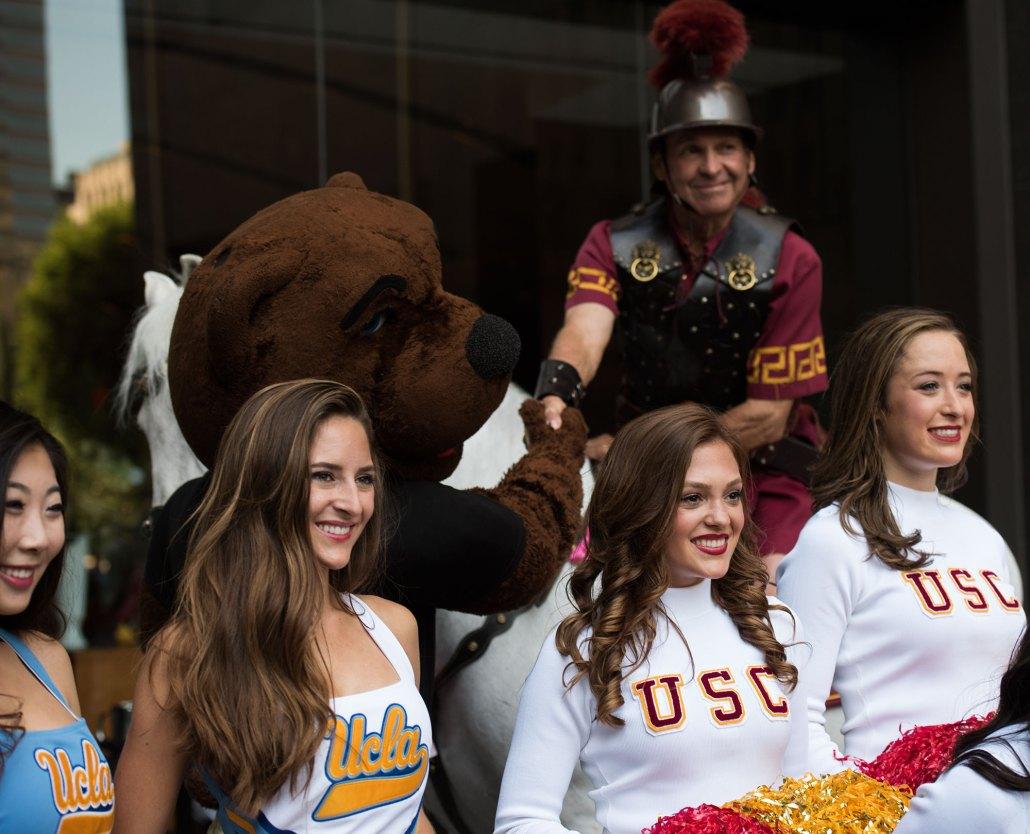 Burying the hatchet · The USC Song Girls, UCLA Spirit Girls and mascots Traveler and Joe Bruin participate in the rally Wednesday. - Mariya Dondonyan | Daily Trojan