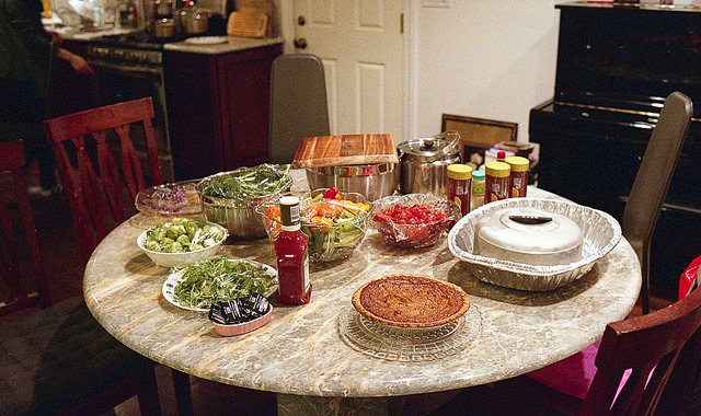 No need to worry about slaving away in the kitchen all day if you host a potluck dinner. Flickr/CreativeCommons