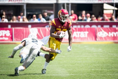 Brian Chin | Daily Trojan Inopportune injury · Senior running back Justin Davis was carted off the field during Saturday's win over Colorado with a high ankle sprain. Davis is USC's leading rusher this season with 476 yards through six games.