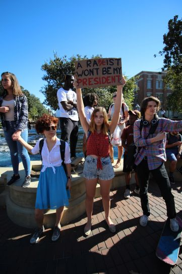 Ellice Wang | Daily Trojan Speaking up · Middle and high schoolers along with USC students demonstrated their displeasure at the prospect of a Trump presidency on campus on Thursday. USC students also marched in the streets around campus.