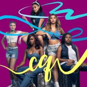 "The image depicts the five members of Citizen Queen, from left to right, Cora Isabel, Kaylah Sharve', Nina Nelson, Hannah Mrozak and Kaedi Dalley. They stand in front of a hot pink background with blue and yellow ribbons, the latter of which spells ""CQ."""