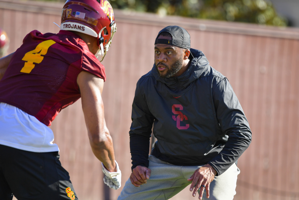 USC wide receiver coach Keary Colbert in a drill with a player in practice.