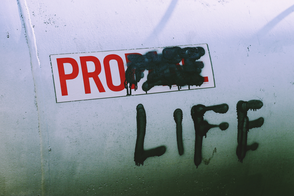 """Propane tank with """"PANE"""" crossed out and """"LIFE"""" graffiti over it."""
