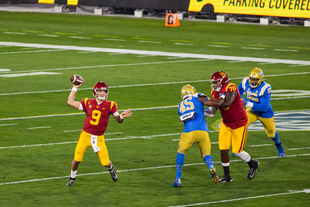 Kedon Slovis holding a ball in his right hand in a game against UCLA.