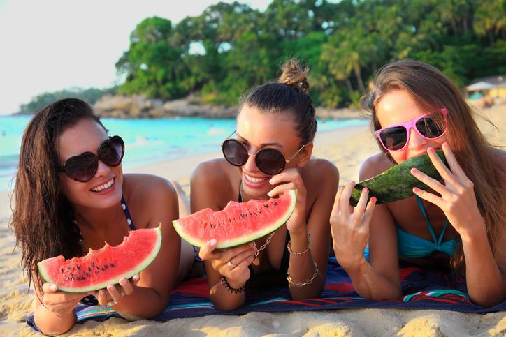 women eating watermelon
