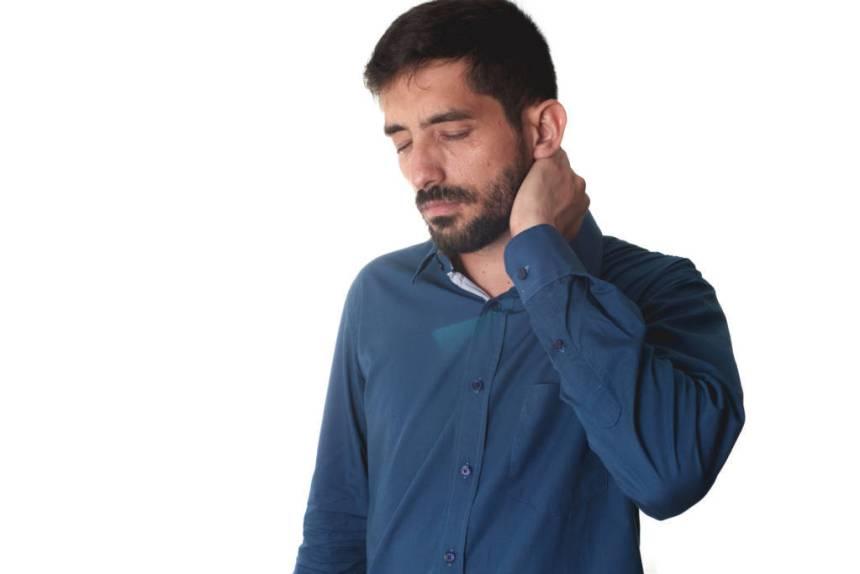 man touching neck