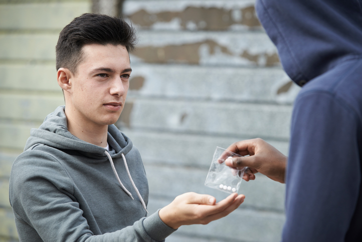 teen buying drugs