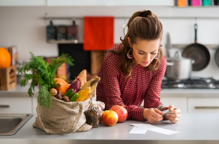 woman in kitchen, groceries