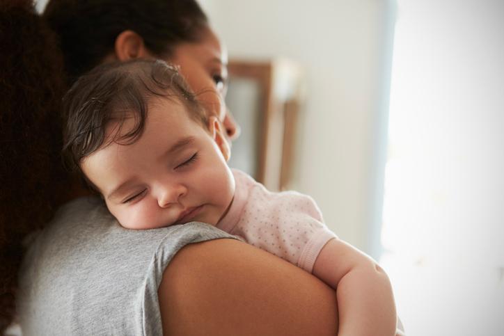 hispanic woman with baby