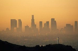 view of downtown LA skyline through the polluted fog