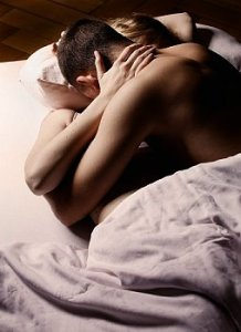 Couple being intimate in bed